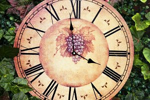 Old antique wall clock with grape picture on them