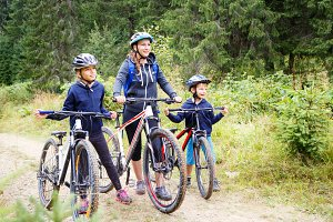 A girl with mother and brother enjoying cycling