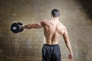Man training shoulder muscle