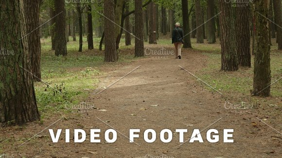 Woman Walks In The Park Autumn Daytime Smooth Wide Dolly Shot