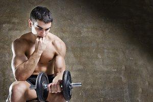 Serene man training weights