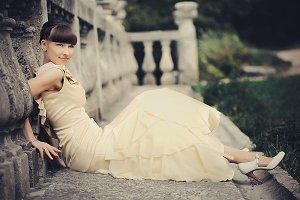 Woman in beige dress rests