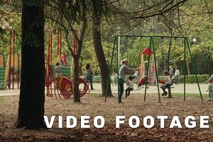 Children on the swing. Autumn daytime. Smooth dolly shot