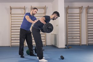coach instructor weight bar exercise