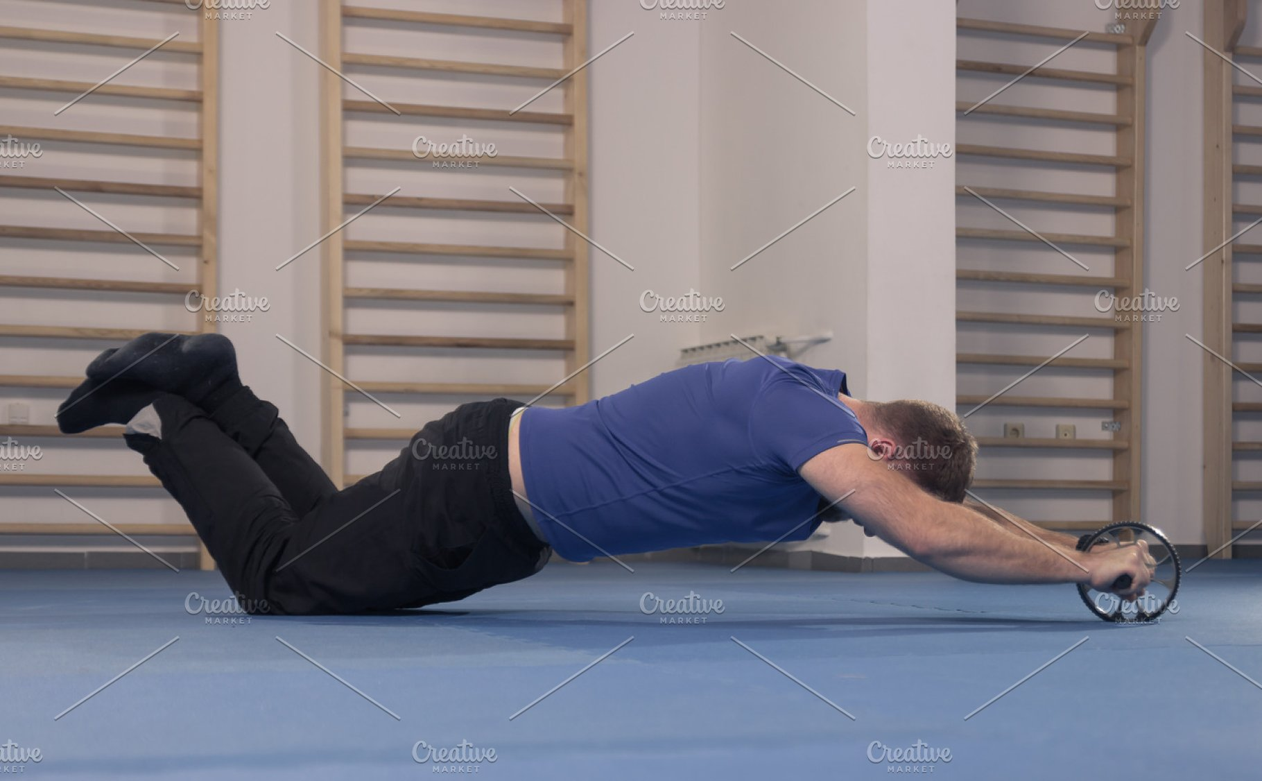 Man Exercise Abs Roller