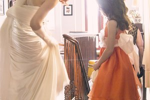 Bride Shows Shoes To Flowergirl