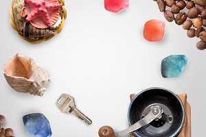 Shells, stones, key, coffee grains isolated on white with clipping path