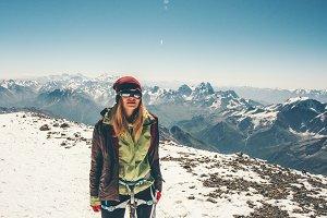 Woman climber on mountain summit