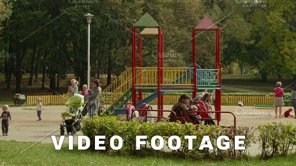 Young Mothers With Children On Playground Autumn Daytime Smooth Dolly Shot
