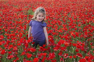 Smiling girl in flowers