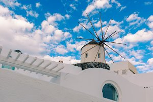 White windmills in Oia, island Santorini, Greece