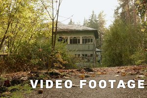Abandoned kids camp in the forest. Autumn daytime. Smooth dolly shot