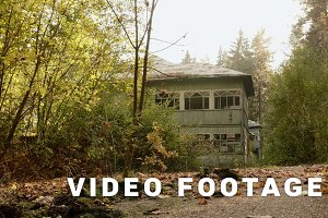 Abandoned house in the forest. Autumn daytime. Smooth dolly shot