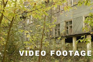 Overgrown kids camp in the forest. Autumn daytime. Smooth dolly shot