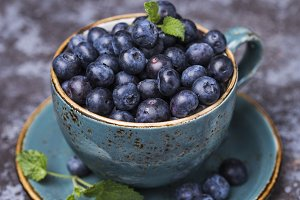 Fresh blueberries in small mug