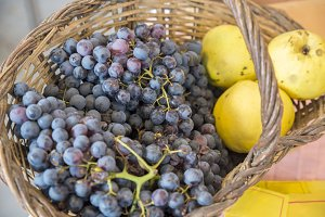 basket of grapes and apples