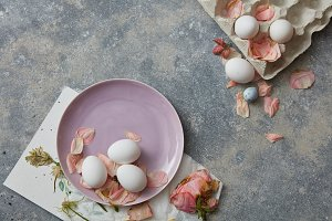 White eggs on pink plate