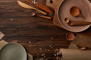 Wooden table with cooking utensils