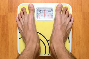Bare feet with weight scale
