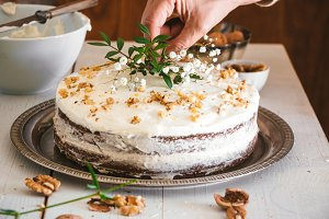 Decorating carrot cake with flowers