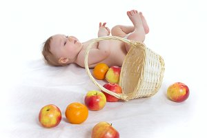 Little boy with basket of apples