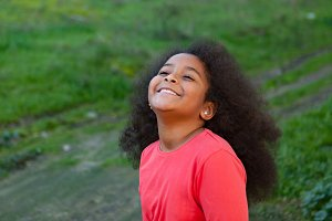Smiling girl with afro hair