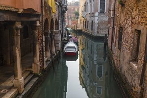 Venice canal with motorboats