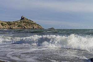 Strong surf on a sandy beach.
