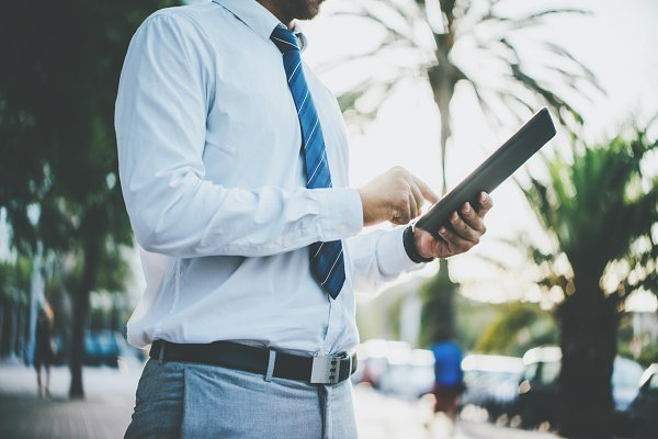 Businessman with device outdoor
