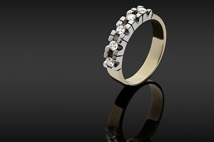 Female gold ring with diamonds