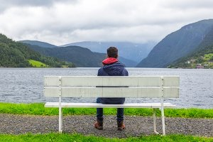 Boy looking at the fjord, Norway