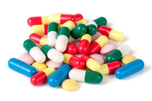 pile of colorful pills isolated on white background
