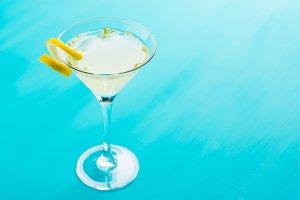 Yellow martini cocktail with lemon