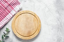 Pizza board and checkered tablecloth