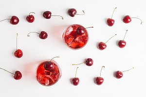 Red cocktail with cherry