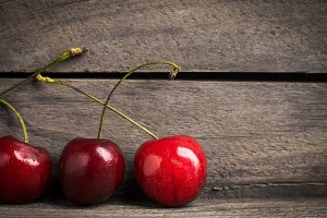 Cherry on the rustic background