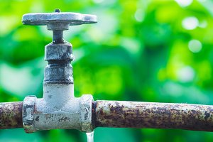 Old water tap in the garden