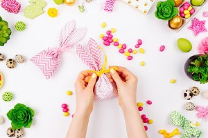 Woman wraps treats. Easter concept