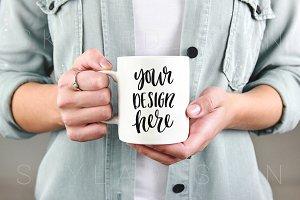 White mug mockup, woman holding