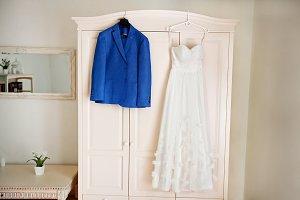Beautiful dark blue grooms jacket and brides dress