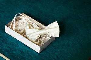 Luxury silk bow-tie in decorated box on dark background