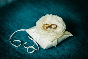 Luxury wedding golden rings on flower