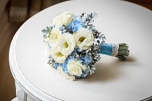 Wedding bouquet of flowers on table.