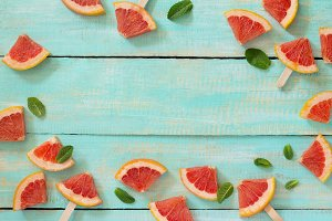 Slices of red grapefruit popsicle