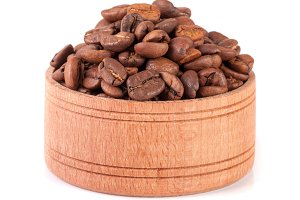 coffee beans in a wooden bowl isolated on white background