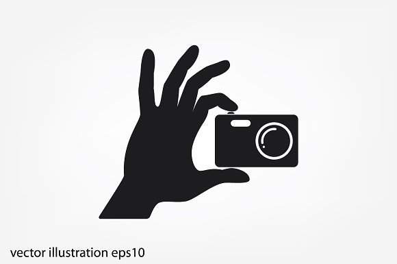 Hand And Photo Camera