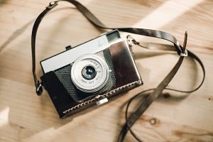 film camera on wooden background
