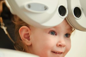 Healthcare - little cute girl in ophthalmologist room