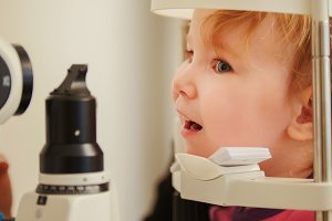 Little girl in ophthalmological clinic checks eyesight