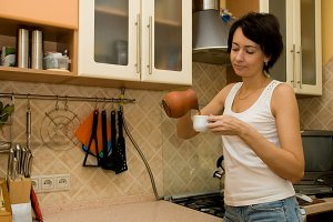 woman prepares coffee
